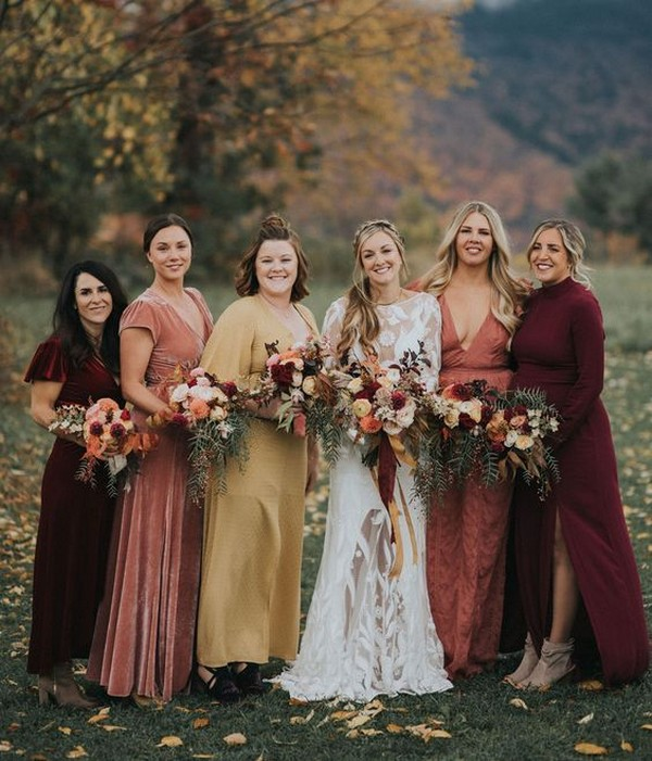 Burgundy bridesmaids and some of the warmest fall colors for this autumnal wedding