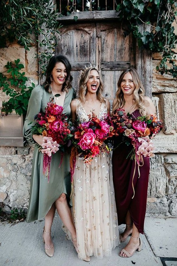Mismatched bridesmaids with unstructured pink bouquets