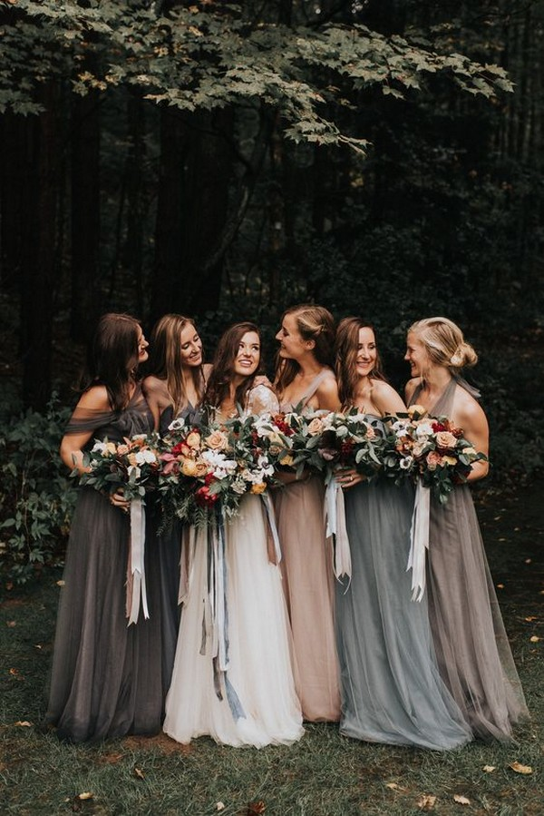 Moody bridesmaid photos with grey, blush and blue mismatched dresses
