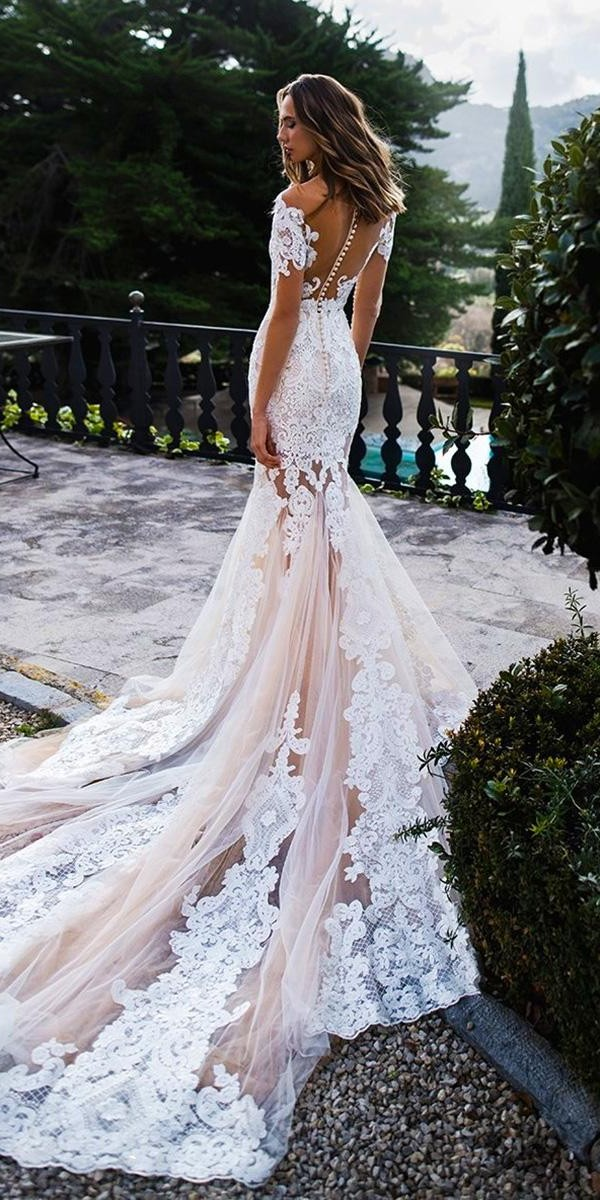 mermaid wedding dresses with illusion long sleeves full lace tattoo effect back train noranaviano